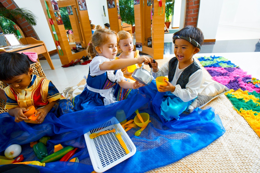 EtonHouse pre-school role playing with children.jpg
